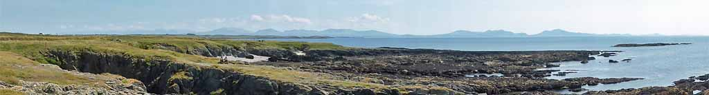 View of Snowdonia Mountains across Aberffraw Bay from Braich-lwyd.