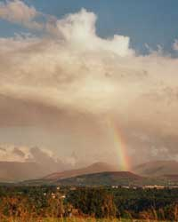 Rainbow over the Snowdonia Mountains seen across the Menai Strait from Four Crosses at 1825 GMT on 20 August 2000. Photo: © D Perkins.