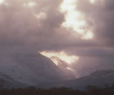 Fresh snowfall in the Nant Ffrancon Pass with crepuscular rays on 10 Feb 2000.