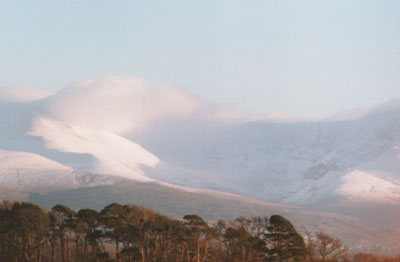 Cloud hanging over snow covered Carneddau Mountains and Ysgolion Duon at 1300 GMT on 10 Feb 2000.