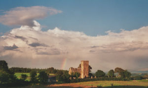 Rainbow beyond Llanidan Church (Anglesey) at 1825 GMT on the evening of the 20 August 2000. Photo: © D. Perkins.