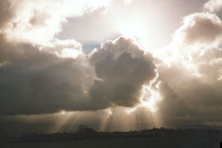 Crepuscular rays through cumulus clouds across the Menai Strait on 31 October. © D. Perkins.