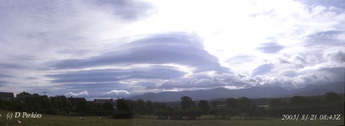 Complex cloud formations including piles-of-plates viewed across the Menai Strait towards the Snowdonia Mountains on 21 August 2003.
