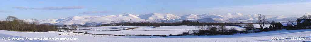 Snowdonia Mountains under blanket of snow.