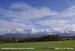 Line of stratocumulus clouds over Snowdonia Mountains viewed from Llansadwrn.