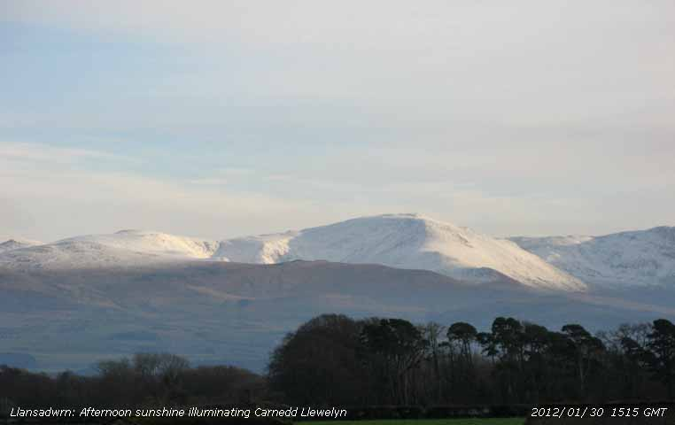 Afternoon sunshine on snow covered Carnedd Llewelyn.