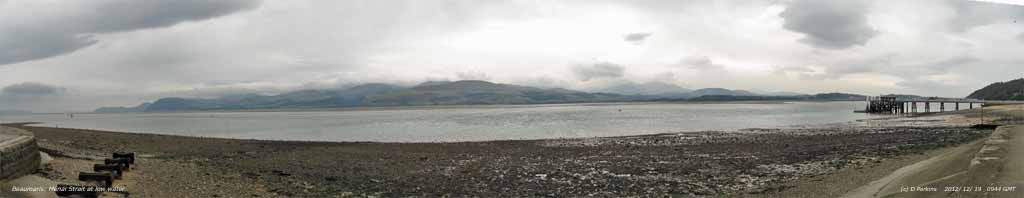 At Beaumaris a view of the Strait at low water with a few spots of rain.