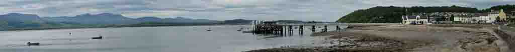 Menai Strait and Pier at Beaumaris on a cloudy morning.